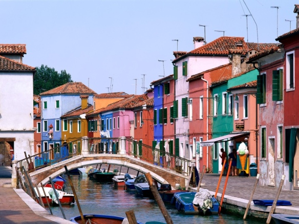 photo of brightly painted homes along the canal in Burano, Italy